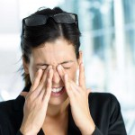 Exhausted and tired eyes business executive woman. Businesswoman stress and problems in job.